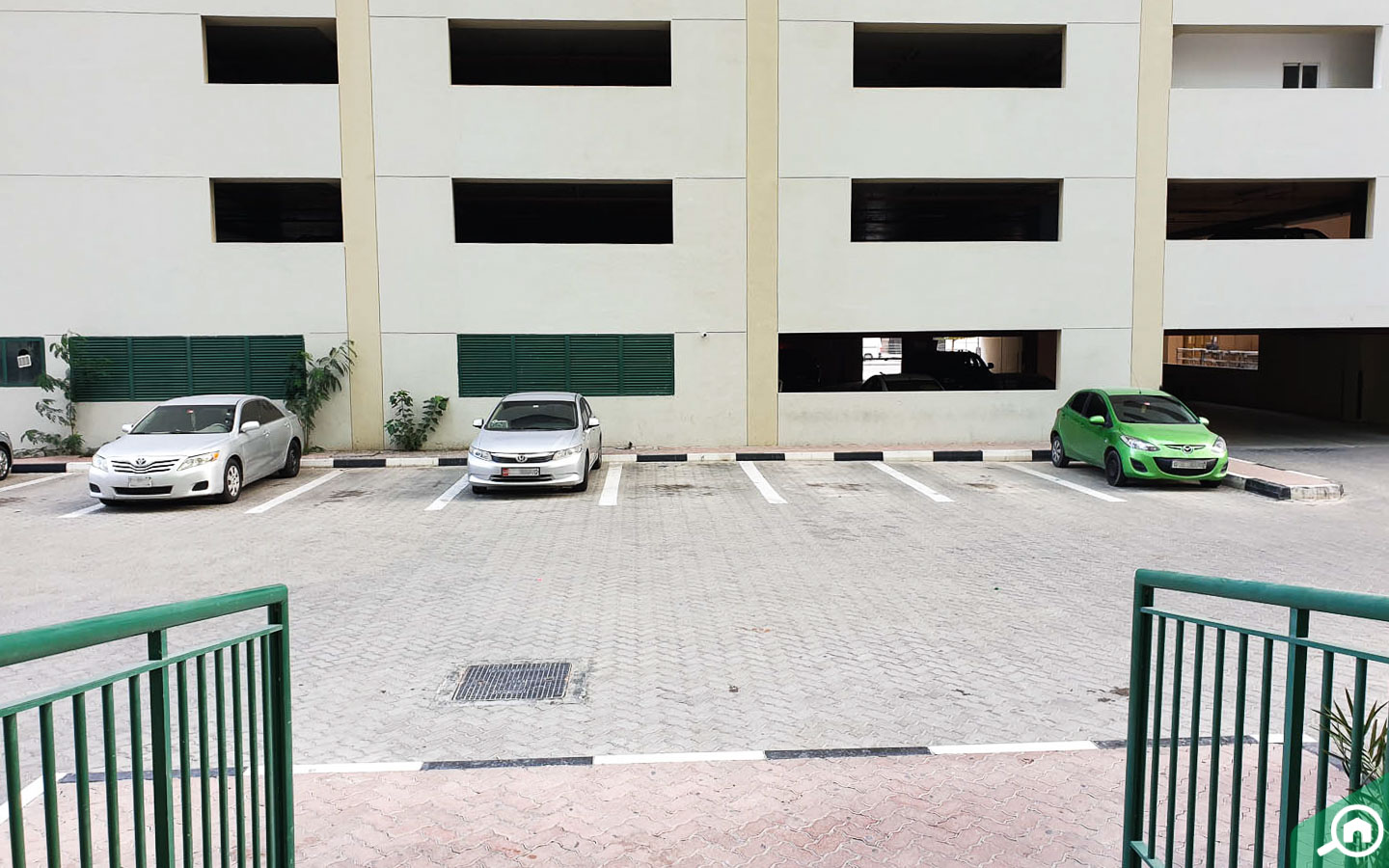 A parking plaza located behind Al Attar Tower