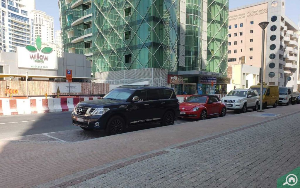 street view of cars parked outside