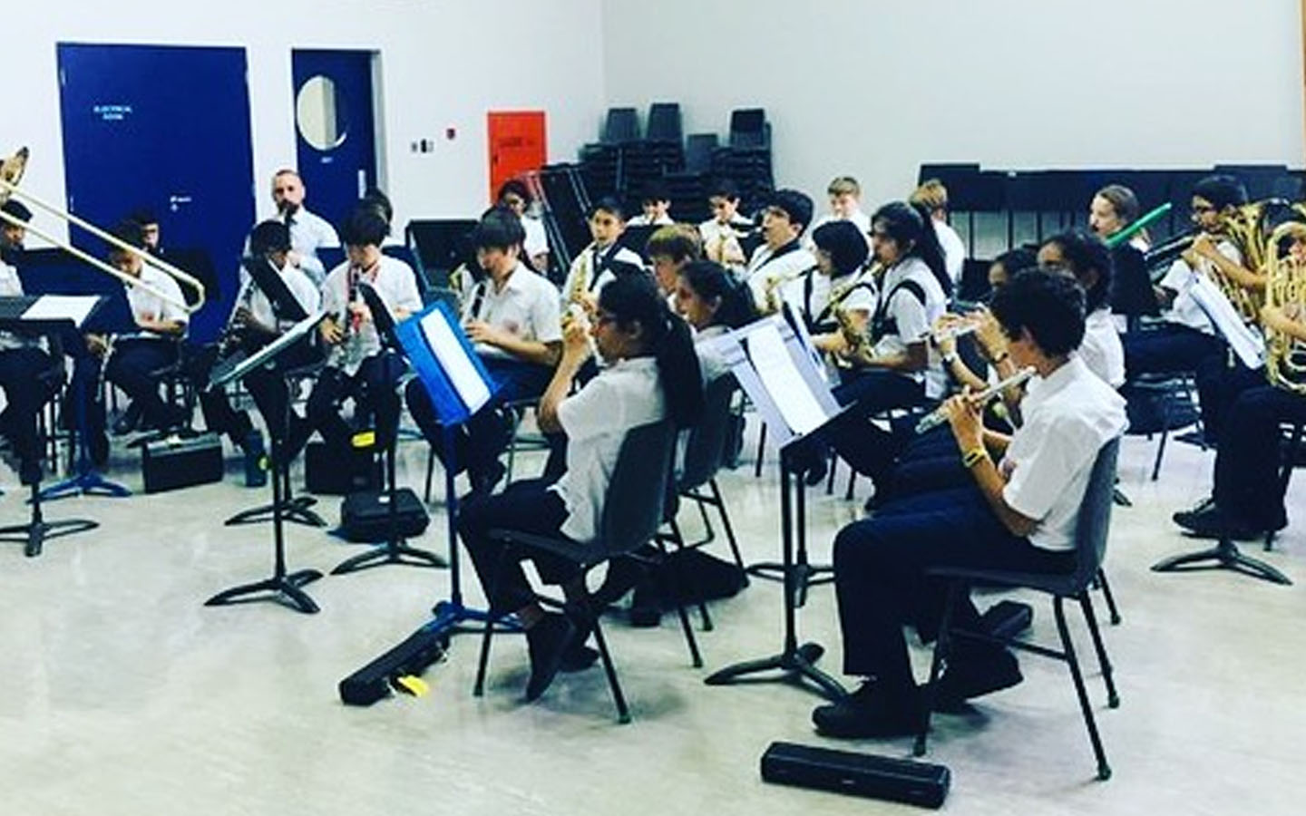 Students of Dubai College playing musical instruments