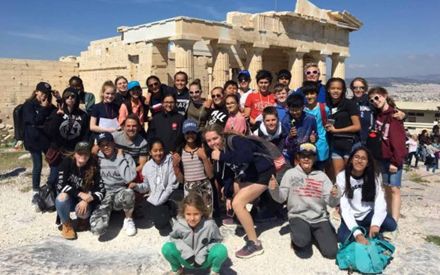 Students of Dubai College standing outside historic location in Greece