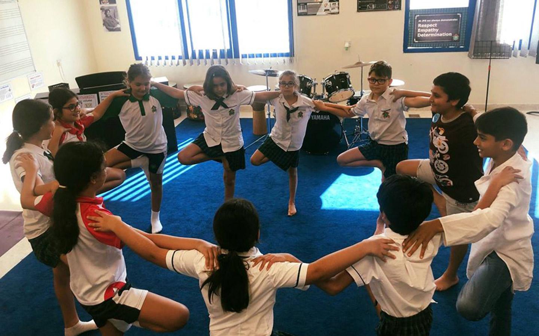 Children performing yoga at GEMS Jumeirah Primary School