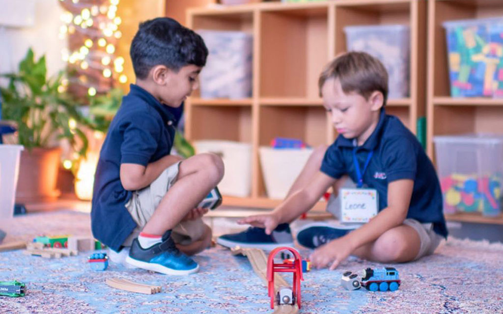 Elementary Students of American School of Dubai playing with toys to learn