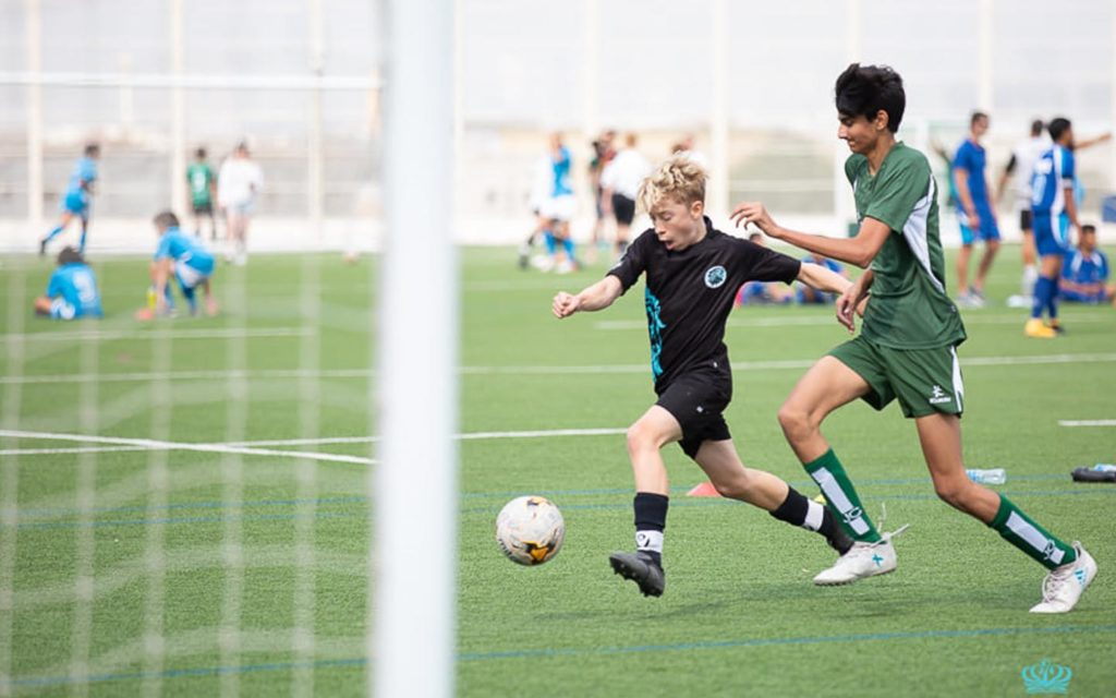 Students of Nord Anglia International school playing soccer