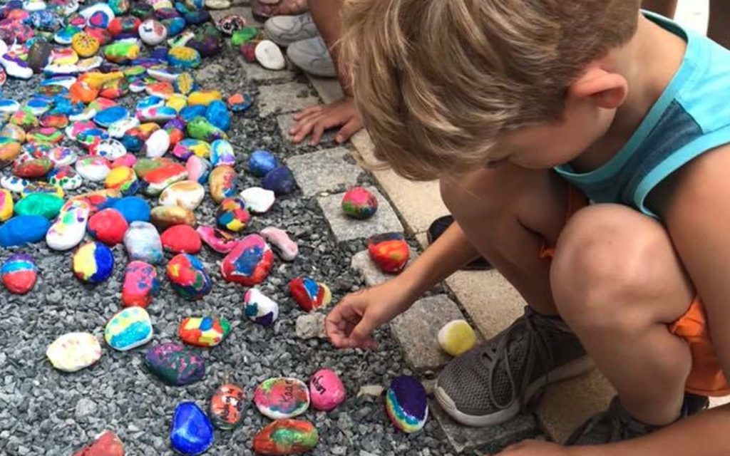Students of Sunmarke School painting stones