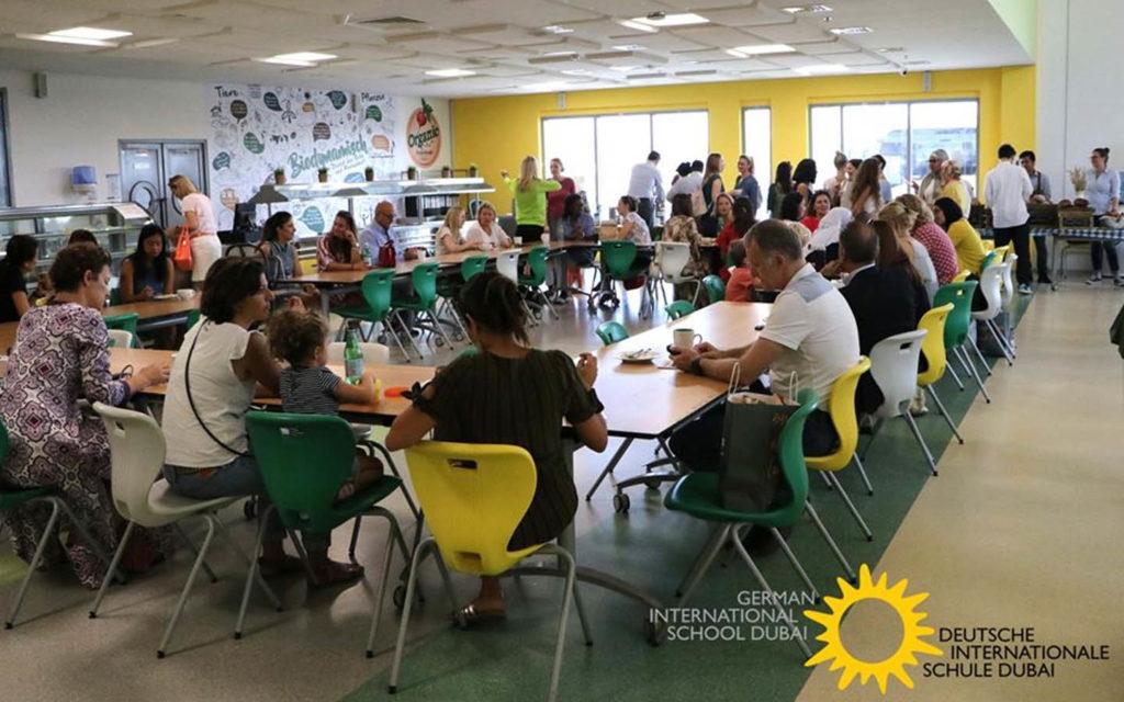 Parents attending a meeting at German International School