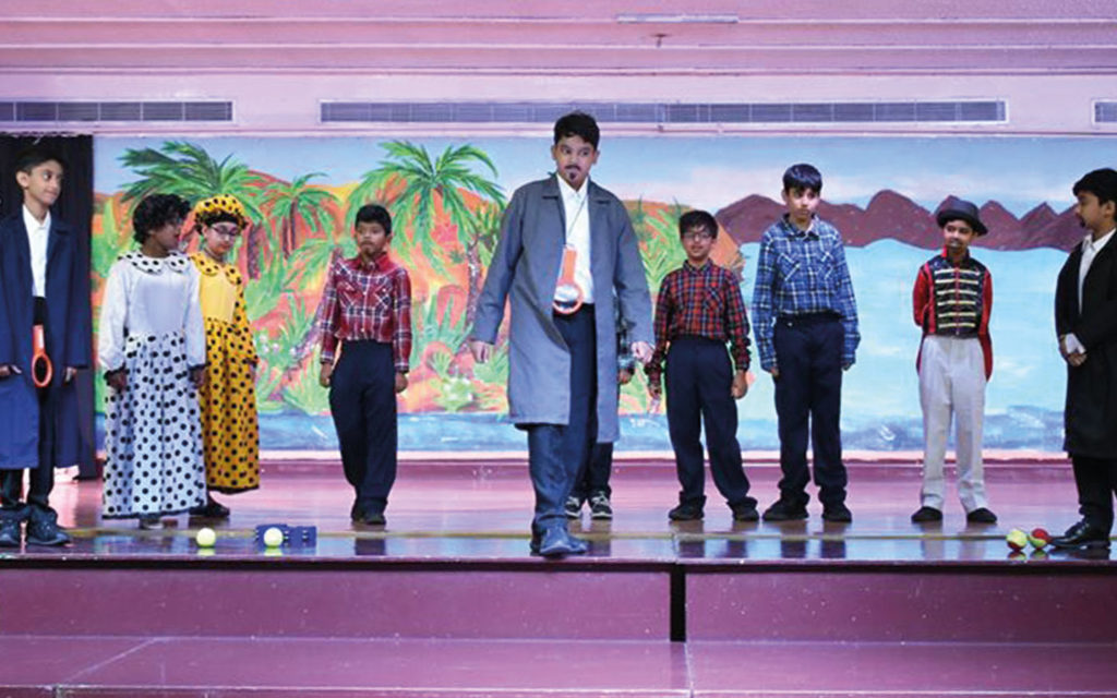 Students of Dubai Gem Private School performing on stage