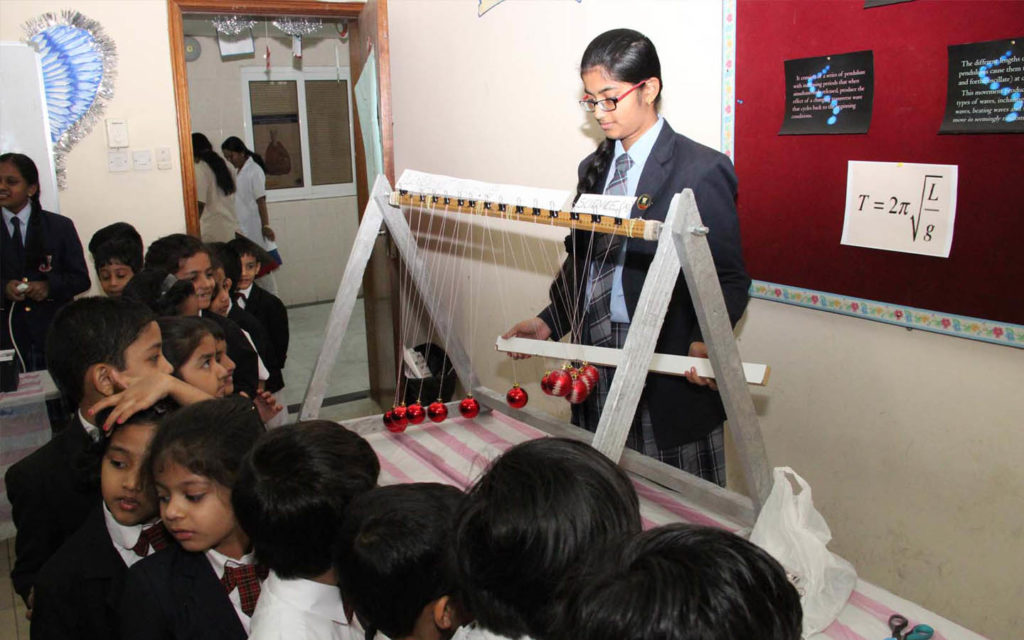 students understanding science experiments through the ENSECO programme at Emirates National School Sharjah