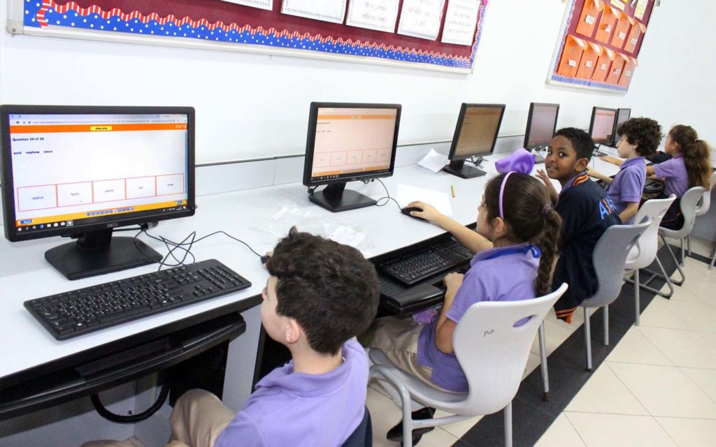 Computer lab with updated computers at Alitqan American School