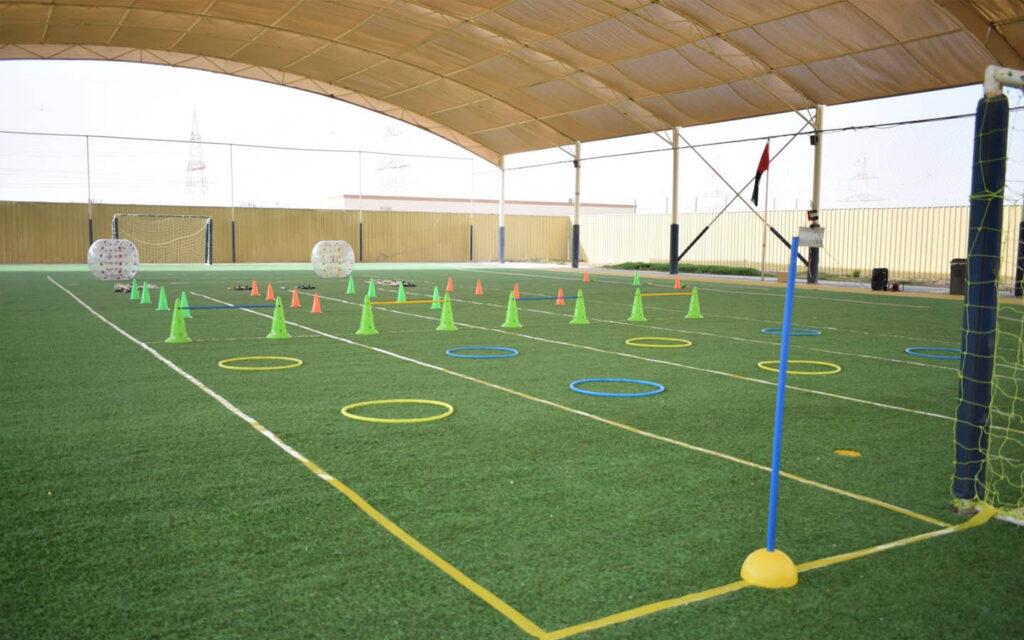 Outdoor football field at Al Resalah American International School